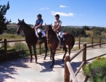 Two-People-Horseback-Riding-in-Barrel-Springs-Antelope-Valley-300x205