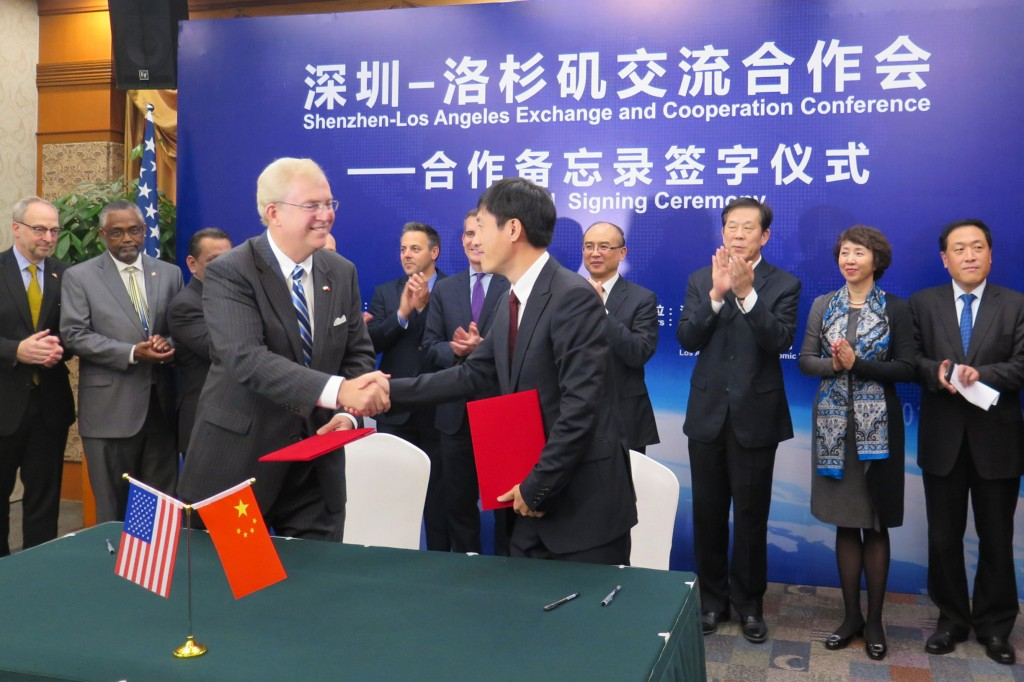 LAEDC CEO Bill Allen and CCPIT Shenzhen President Yongxin Tao shake hands after signing historic MOU for bilateral cooperation on trade and investment between the regions.  Nov 18, 2014