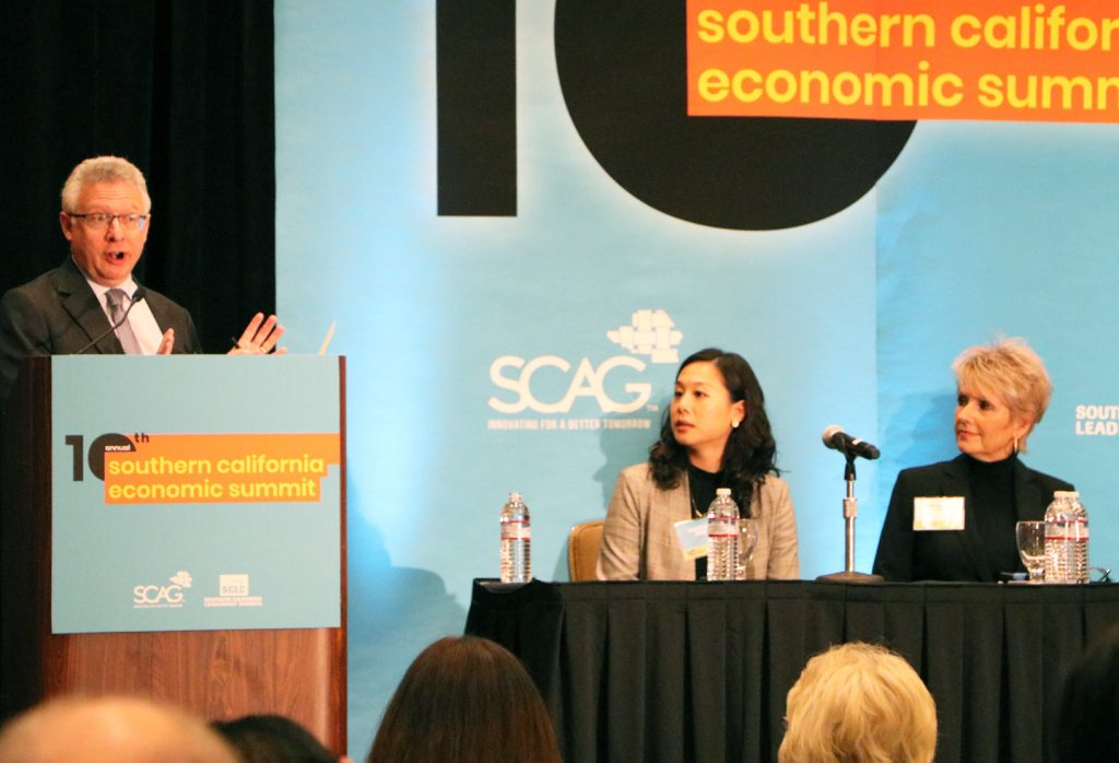 LAEDC's Judy Kruger (R) spoke about the upcoming EV industry report at SCAG's Economic Summit
